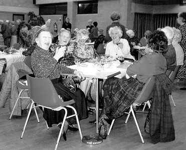 <center><font size=3><u> - W.I. New Year's Party - </u></font> (BS0561) In present Parish Hall (year not known).  See Benson Bulletin Vol 18, No 8, Page 14.  L to R: Inez Taylor, Hilda Morgan, Mollie McKrill (eye mask), Iva Davies (glass raised), Gwenda Yeates (back to camera)