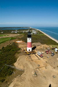 The position of Sankaty Lighthouse in 'Sconset, MA on Nantucket Island at noon on October 2nd. The lighthouse began it's move on October 1st. The concrete pad surrounded by orange fencing is its new destination.