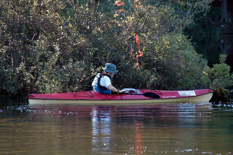 <b>Darrell at control number 1</b>   (Sep 11, 2004, 09:09am)  <p align=left>The canoe launch was only a quick one minute run from the start, and control number 1 was only about 100 feet from the canoe launch. When a new contestant started (and we were not that busy), I would run down to the canoe launch to take pictures of the contestant leaving the canoe launch and punching the first control.</p>  <p align=left>Here you see Darrell at control number 1. Darrell punched this control right away. Many contentants paddled right past control 1 (intentionally or by accident) and had to punch that control when they returned to the canoe launch.</p>