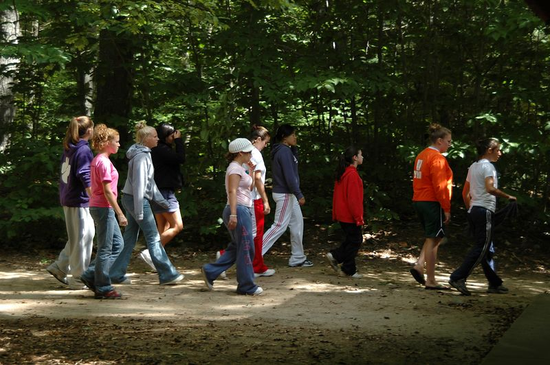 <b>The woods were filled with packs of wild girls</b>   (Sep 11, 2004, 12:04pm)  <p align=left>You can tell that these girls are not orienteering.  For one thing, they do not have a map.  Then there is the fact that they are walking around in a large group (orienteering is usually done solo or in a very small group).  But they are in the middle of one of the courses, slowly walking towards the finish area.  Just one of the hazards that a runner must avoid (sort of like cliffs).</p>