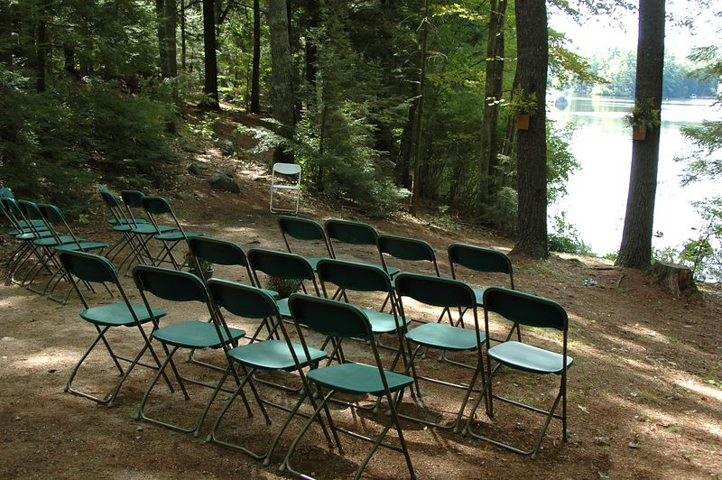 <b>Setup for a wedding by the lake shore</b>   (Sep 11, 2004, 12:14pm)  <p align=left>As I mentioned before, the group picnic area was not available to us this year because it was being used by a wedding.  Yes, some happy couple decided to tie the knot at the edge of Pawtuckaway Lake, in the middle of a state park.  While I was down at the water taking pictures of  canoers, I took this shot of the wedding area a few hours before the blessed event.</p>
