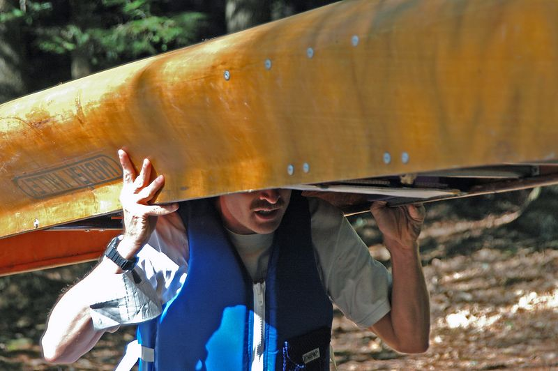 <b>JJ Cote also starts the canoe-O on land</b>   (Sep 12, 2004, 10:05am)  <p align=left>JJ also grabbed his canoe at the canoe launch, and started running down the trail.  But JJ went running off in a different direction than Aims.</p>