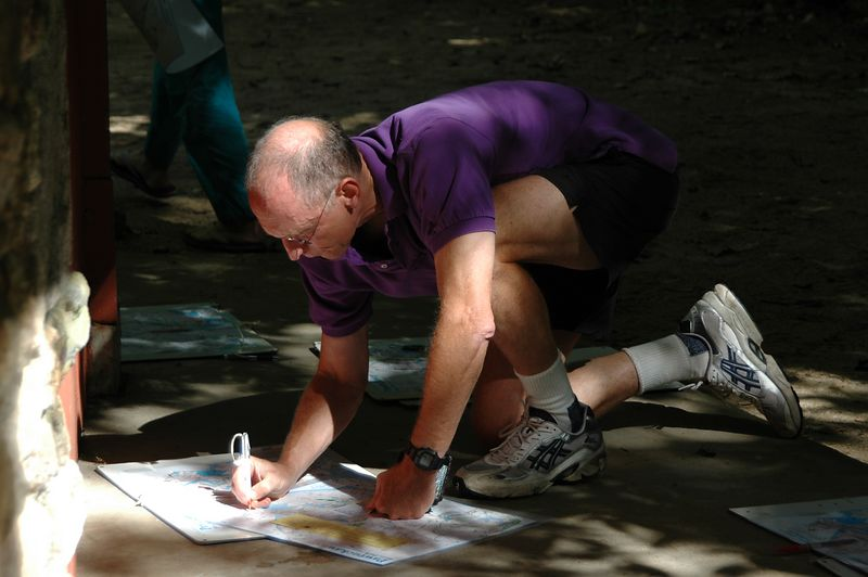 <b>Charlie DeWeese copies his course</b>   (Sep 11, 2004, 10:49am)  <p align=left>Although we like to think that the canoe orienteering is the main attraction, most of the people who come to Pawtuckaway for the second weekend in September are their for the foot orienteering.</p>  <p align=left>Here is the first of a number of shots of people participating in the foot orienteering.  You can easily tell the difference; foot-O racers do not bother to wear life jackets.</p>