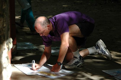 Charlie DeWeese copies his course   (Sep 11, 2004, 10:49am)  Although we like to think that the canoe orienteering is the main attraction, most of the people who come to Pawtuckaway for the second weekend in September are their for the foot orienteering.  Here is the first of a number of shots of people participating in the foot orienteering.  You can easily tell the difference; foot-O racers do not bother to wear life jackets.
