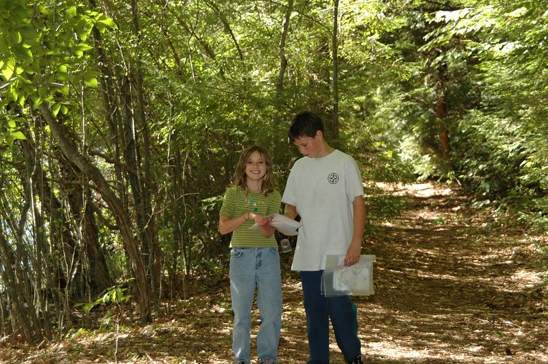 <b>Two younger racers stop to check their map</b>   (Sep 12, 2004, 11:01am)  <p align=left>I caught Mary  and Calvin Underwood in the middle of running the White course (foot-O).  The Sunday White course went right by the canoe launch.</p>