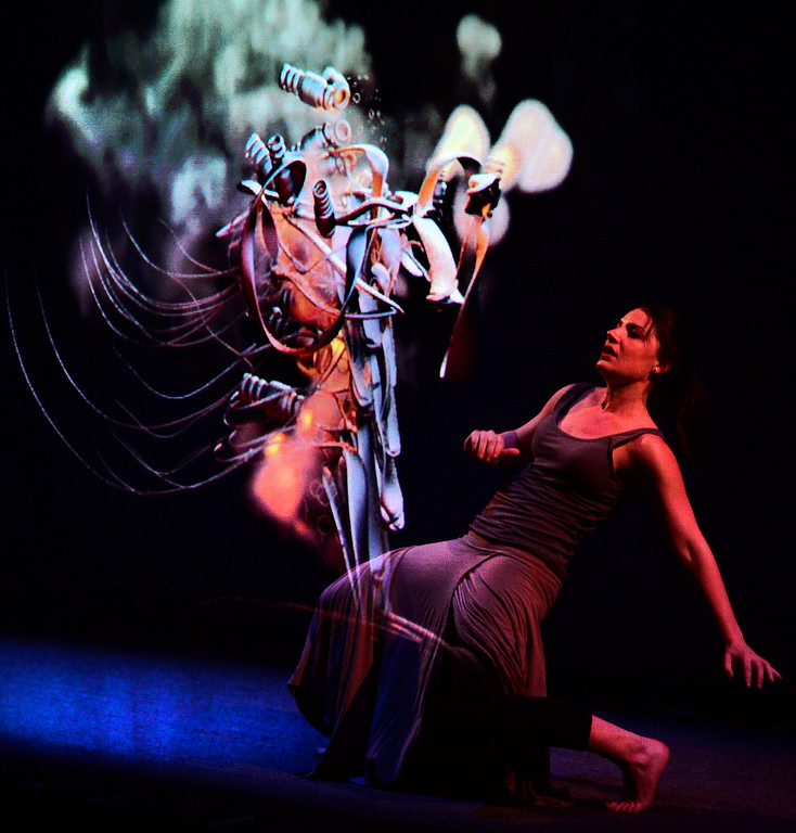 . Leah Woods falls back away from a whirling projection of a machine like image during a performance of Origin Stories at the ATLAS Black Box as part of the Conference on World Affairs Thursday. The dance and visual production, are a part of Artist Kenji Williams\' BELLA GAIA project.  For more photos from the performance go to www.dailycamera.com Paul Aiken Staff Photographer April 13, 2017