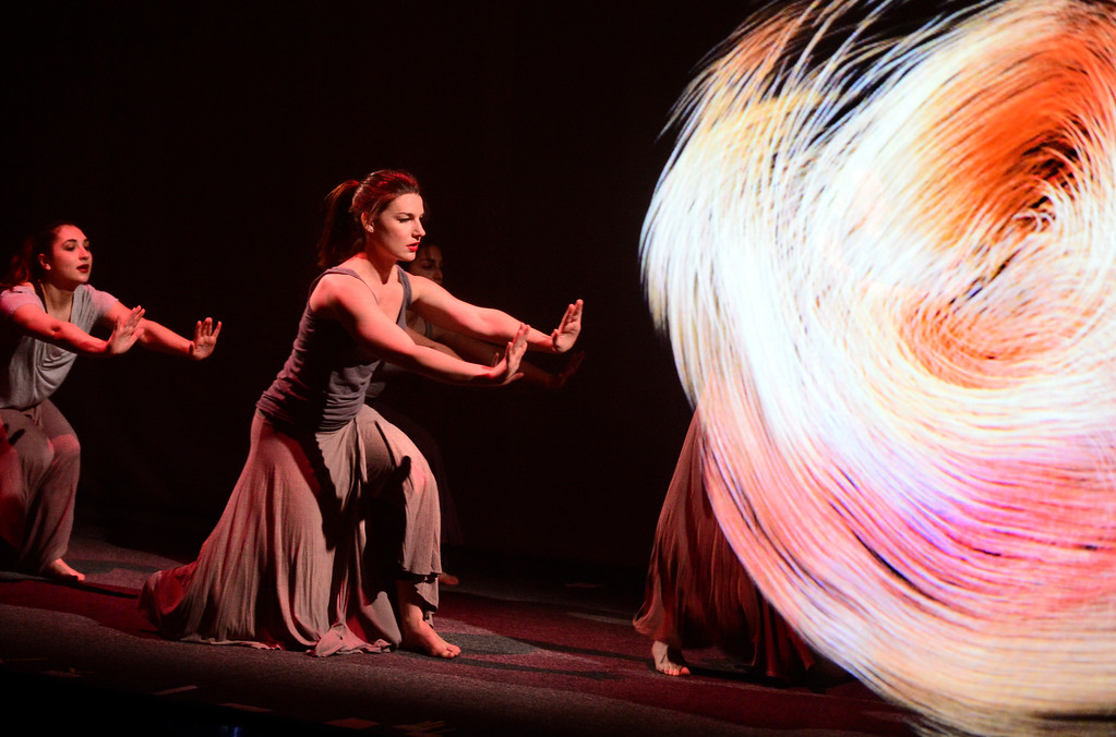 . Dancers Sara Varro, left and Leah Woods react to a whirling image during a performance of Origin Stories at the ATLAS Black Box as part of the Conference on World Affairs Thursday. The dance and visual production, are a part of Artist Kenji Williams\' BELLA GAIA project.  For more photos from the performance go to www.dailycamera.com Paul Aiken Staff Photographer April 13, 2017