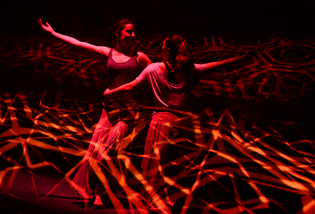 . Leah Woods, left and Sara Varro whirl together during a performance of Origin Stories at the ATLAS Black Box as part of the Conference on World Affairs Thursday. The dance and visual production, are a part of Artist Kenji Williams\' BELLA GAIA project.  For more photos from the performance go to www.dailycamera.com Paul Aiken Staff Photographer April 13, 2017