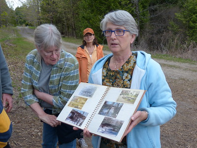 Tish Godfrey with photo album which documents the property changes since the 70's