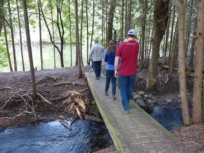 Bridge over Cobourg Creek leading to stream-side pond