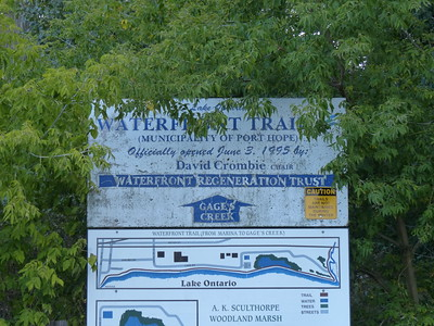 Sign at parking lot with access to the waterfront trail and AK Sculthorpe Woodland Marsh