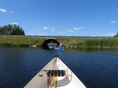Paddling through the culvert with the Loons heading back out to the lake