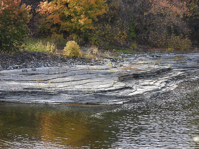 Layers of rock exposed by low water levels in the Trent River