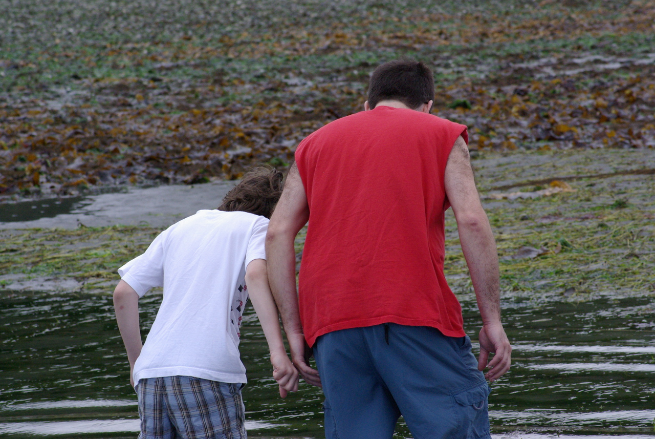 Paul and Max exploring the very low tide at Edmonds Beach.