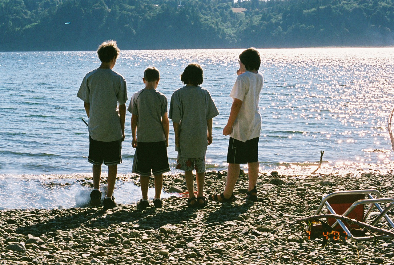 Four boys contemplating fire.  Vashon Island, July 4th weekend, 2007.