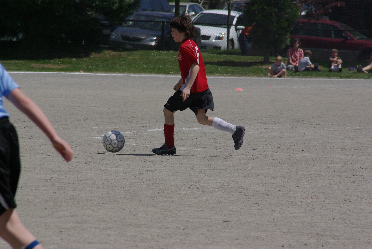 Max works the ball.  love the mismatched socks