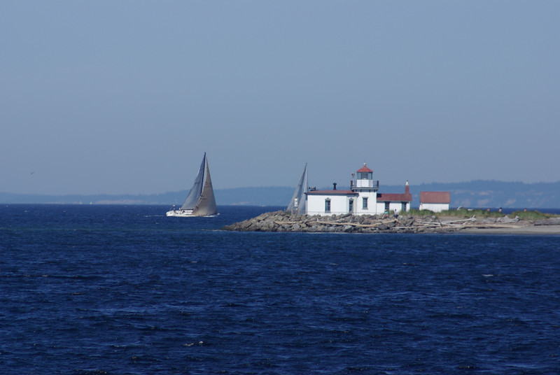 West Point lighthouse, with racing sailboats