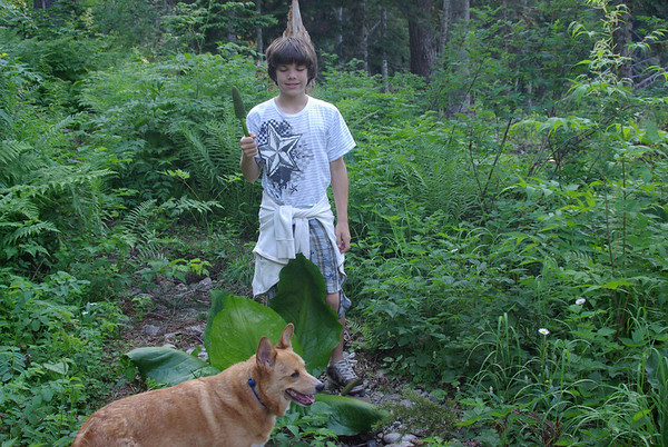 Max with parts of giant plant.  Frodo in front.