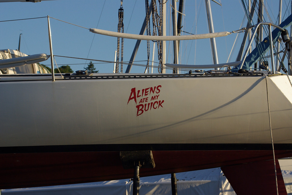 """Interesting name for a boat.  the back transom said """"Sailboat racing isn't life or death...it's far more important than that."""""""