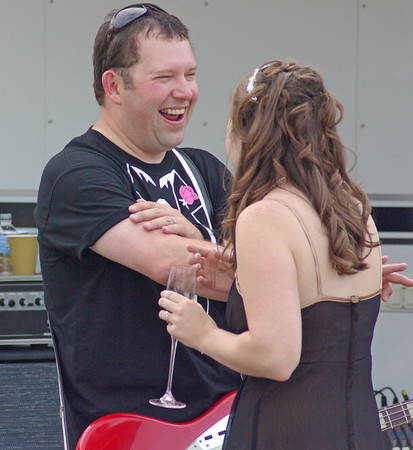 Jeff and the bride, Jen, share a laugh.