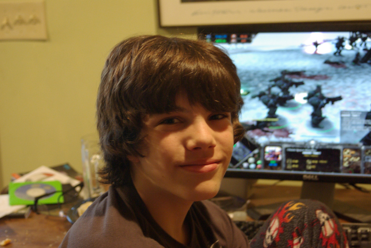 My son Max in front of his favorite game, Dawn of War. 06/16/09