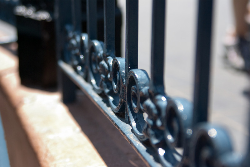 Daily 08/12/10: detail of the railing from the Pirates of the Caribbean ride at Disneyland.  Long line, had camera.