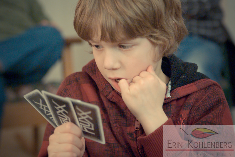 theme: the people in our lives focus: photographing faces.  I was just shooting them playing cards. this one just captured his concentration. my nephew C is 7 and is so cute, he has a very expressive face and i love to photograph him.