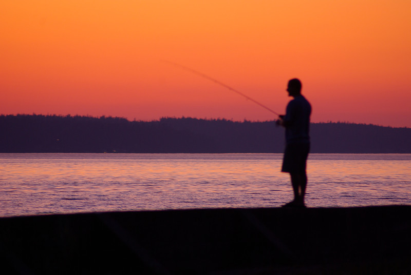 My brother-in-law fishing. July 2009, Cama Beach State Park, WA.