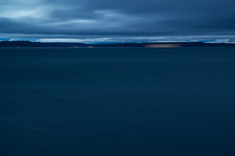 A Washington State ferry in motion on Puget Sound at dusk