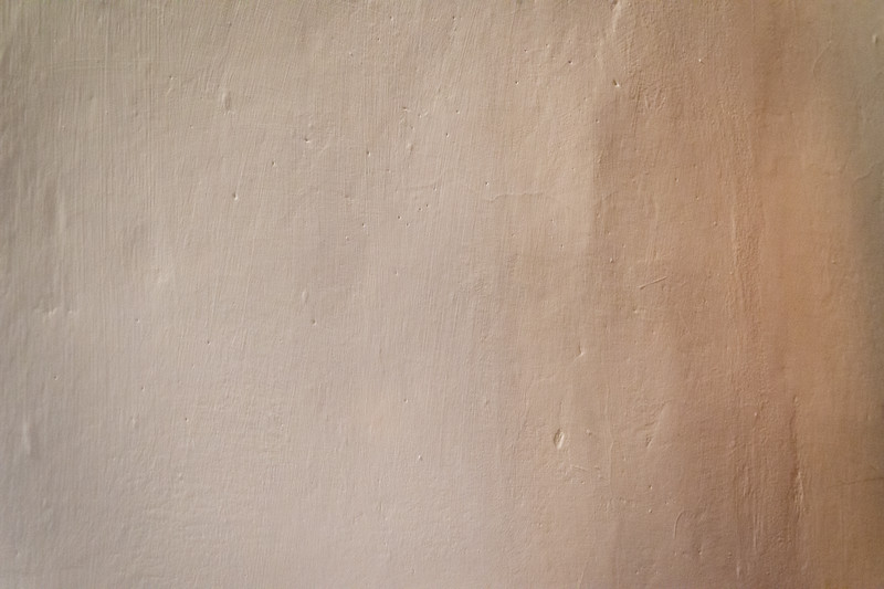 Subtle, soothing details of a plastered wall in Florence, Italy