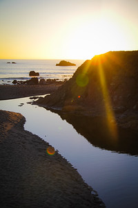 Evening sunbeams on the beach at Scotty Creek in Sonoma County, CA