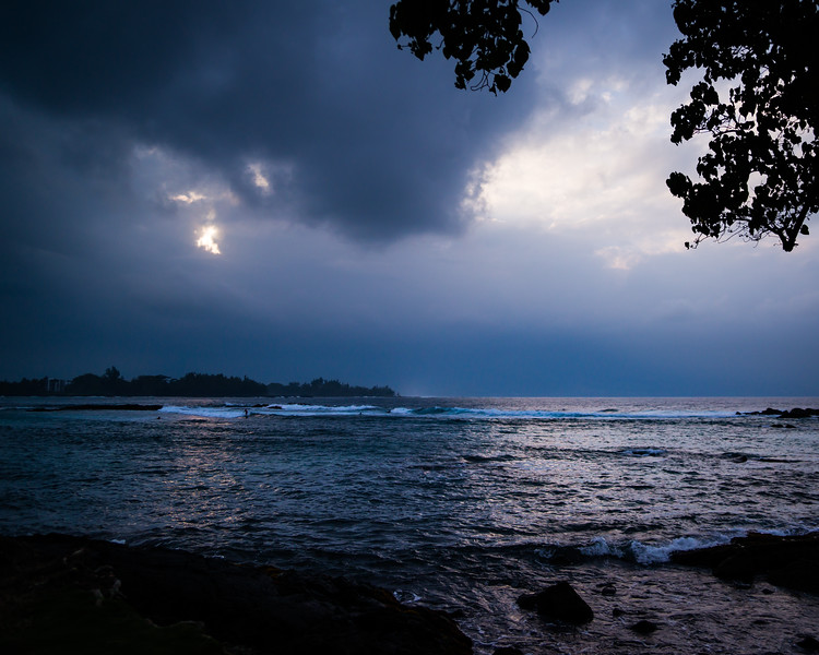 Dramatic clouds and small waves at Richardson Ocean Park in Hilo, HI on a clouded afternoon