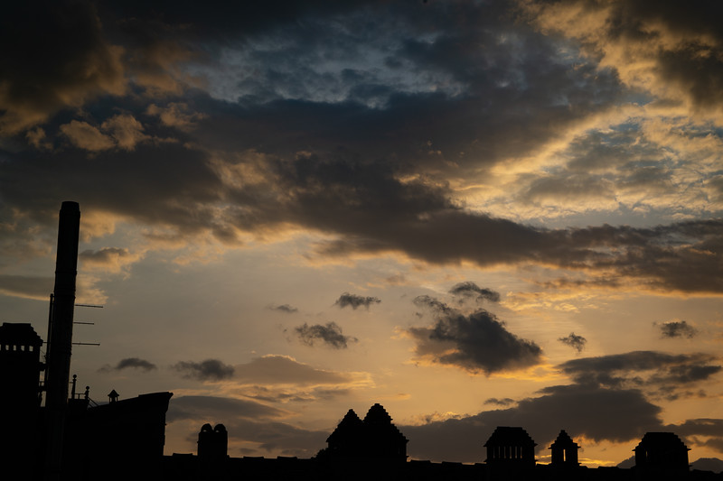 Sunset over the rooftops from Via dei Tavolini, Florence, Italy