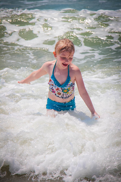 Hailey playing in the waves at Emerald Isle