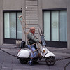Window washer with ladder on vespa
