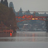 Sunrise glow off of the Montlake Bridge with rower under bridge