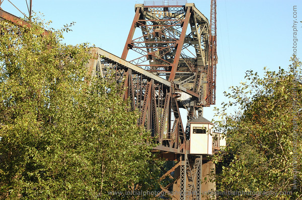 """This picture of the train bridge was taken on an October morning in the <a href=""""http://en.wikipedia.org/wiki/Magnolia,_Seattle,_Washington"""">Seattle neigborhood of Magnolia</a>."""