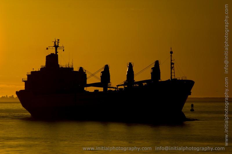 Cargo Ship Setting Sun