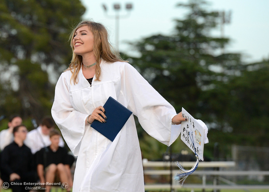 . Virginia Kirkpatrick doesn\'t let her cap falling off dampen her excitement to earn her diploma as Orland High seniors graduate Friday, June 2, 2017, in Orland, California. (Dan Reidel -- Enterprise-Record)