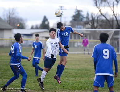 Gridley High's Carlos Velazquez  (9) and Orland's Danny Cardenas (18) go up for the headbutt during a soccer game January 9, 2018 in Gridley, California. (Emily Bertolino -- Enterprise-Record)
