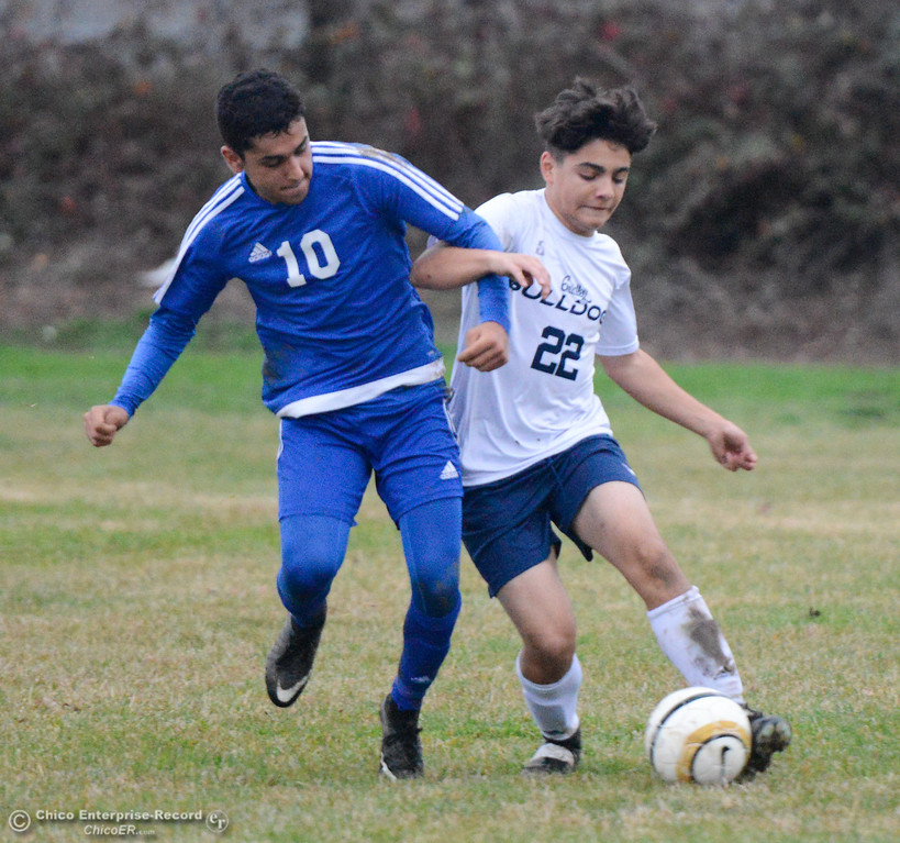 . Orland High\'s Yonathan Esquivel (10) and Gridley High\'s Giovanni DiSalvo (22) work for ball possession January 9, 2018 in Gridley, California. (Emily Bertolino -- Enterprise-Record)