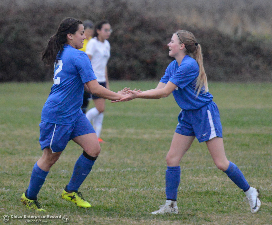 . Orland High\'s Bailey McCarthy (right) congratulated teammate Maggie Castellanos after her goal against Gridley January 9, 2018 in Gridley, California. (Emily Bertolino -- Enterprise-Record)