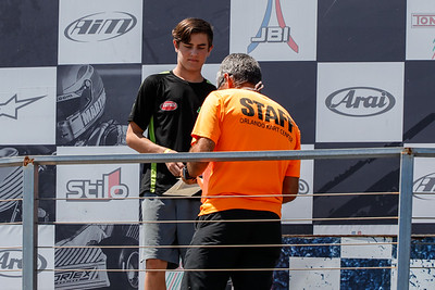 May 17, 2020, Orlando, FL, USA; Track owner Andre Martins hands out driver awards after round two of the Orlando Open race at The Orlando Kart Center Speedway. Mandatory credit: Mike Watters