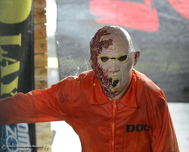A Zombie Wrecking Crew zonbie gets splattered with paintballs during Oro Con on Saturday, June 3, 2017, at Feather Falls Casino in Oroville, California. (Dan Reidel -- Enterprise-Record)