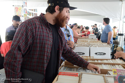 Eric Lizarraga, of Yuba City, sorts through comic books at Oro Con on Saturday, June 3, 2017, at Feather Falls Casino in Oroville, California. (Dan Reidel -- Enterprise-Record)