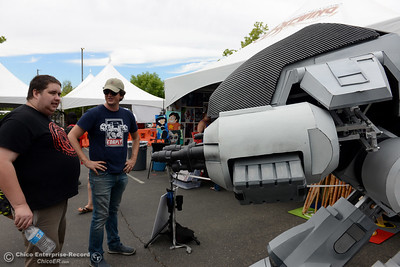 """Gabriel Regan, of Chico, left, takes a look at ED-209, the robot from the """"Robocop"""" movie with one of its creators, David Codeglia, of Ghostlight.com during Oro Con on Saturday, June 3, 2017, at Feather Falls Casino in Oroville, California. (Dan Reidel -- Enterprise-Record)"""
