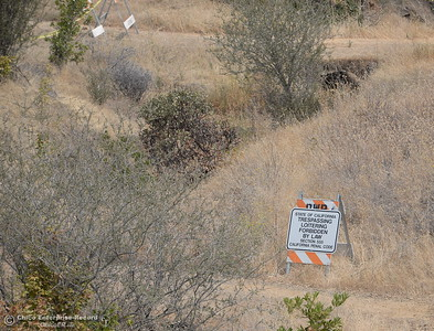 Although locals are getting their first look at the Oroville Dam Spillway since the emergency that closed Oro Dam Blvd. East to the public more than a year ago, the trails down to the river are closed with no tresspassing signs seen Monday, July 30, 2018. (Bill Husa -- Enterprise-Record)