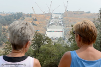 Coleen Willesen left and Fran Obrigewitsch of Oroville get their first look at the Oroville Dam Spillway since the emergency that closed Oro Dam Blvd. East to the public more than a year ago Monday, July 30, 2018. (Bill Husa -- Enterprise-Record)