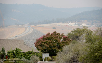 A smokey view of the Lake Oroville Dam is seen from  Beckwourth Ct. in Oroville, Calif. Monday, July 30, 2018. (Bill Husa -- Enterprise-Record)