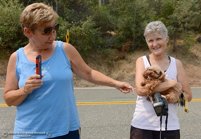 Fran Obrigewitsch, left and Coleen Willesen with her dog Felix of Oroville get their first look at the Oroville Dam Spillway since the emergency that closed Oro Dam Blvd. East to the public more than a year ago Monday, July 30, 2018. (Bill Husa -- Enterprise-Record)